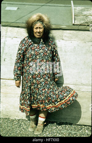 Eskimo woman in colorful outfit; Point Barrow, Alaska. - Stock Image