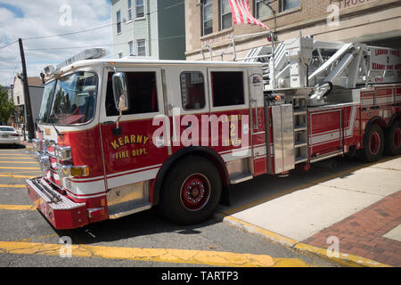 The firetruck ladder truck parked at the fire station at Kearney, New Jersey. - Stock Image
