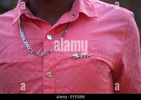 Shirt accessorised with Apple logo buttons, Rwanda, Africa - Stock Image