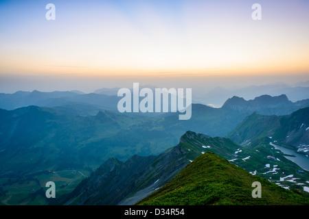 Sunrise mountain panorama from Brienzer Rothorn with purple sky, Switzerland. - Stock Image