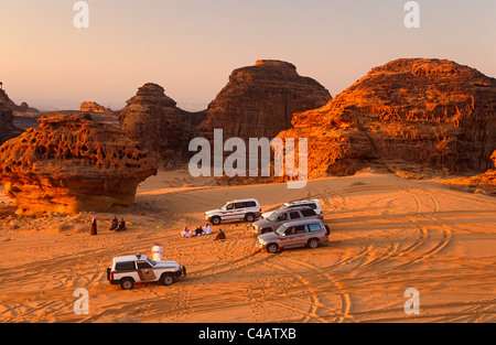 Saudi Arabia, Madinah, Al-Ula. Tourists enjoy 4WD excursions in the spectacular wadis and rugged hills that comprise - Stock Image