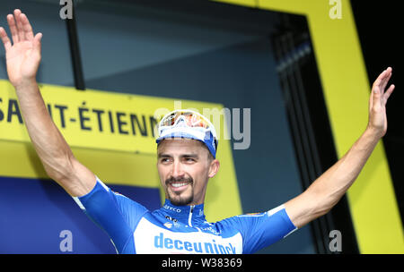 Macon to Saint-Etienne, France. 13th July 2019. Macon to Saint-Etienne, France. 13th July 2019,  Macon to Saint-Etienne, France; Tour de France cycling tour, stage 8; Julian Alaphilippe, Deceuninck - Quick - Step on the podium Credit: Action Plus Sports Images/Alamy Live News Credit: Action Plus Sports Images/Alamy Live News - Stock Image