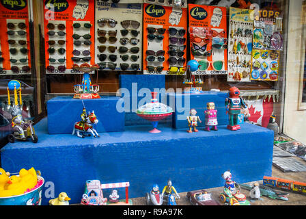 Window of a toy shop in Toronto, Canada  displaying retro clockwork metal toys. - Stock Image