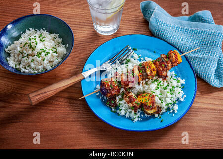Chicken bacon skewers - Stock Image