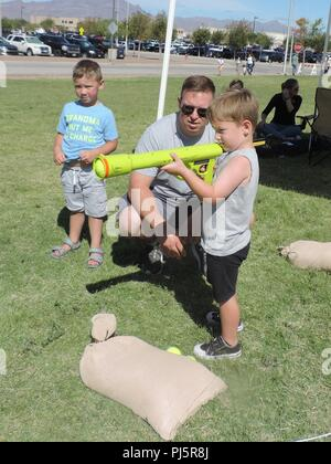 Soldiers with 3rd Armored Brigade Combat Team. 1st Armored Division, participate in 1AD's Family Day Aug. 24. The Bulldogs had games set up for the children along with static displays of their armored vehicles. (U.S. Army photo by Staff Sgt. Felicia Jagdatt) - Stock Image