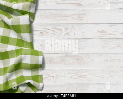 table with grass green picnic cloth top view background - Stock Image
