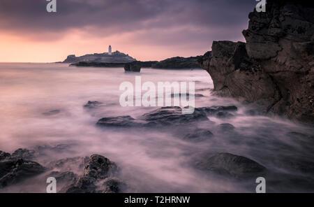 Sunset at Godrevy Point Lighthouse, on the north Atlantic coast of Cornwall, England, UK. - Stock Image