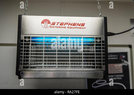 Ultraviolet flying insect zapper made by Stephens Catering Equipment in a hospital ward kitchen. - Stock Image