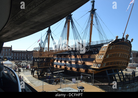 Adm Nelson's HMS Victory imdergoes repairs as seen from the viewing deck of the new Mary Rose Museum at Portsmouth - Stock Image