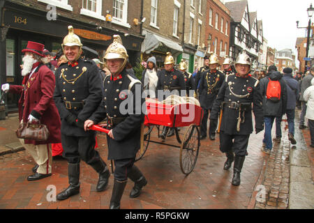 Rochester, Kent, UK - 1st December 2018: A group of Victorian firemen take part in the Dickensian Festival on Rochester High Street.  Hundreds of people attended the Dickensian Festival in Rochester on 1 December 2018. The festival's main parade has participants in Victorian period costume from the Dickensian age. The town and area was the setting of many of Charles Dickens novels and is the setting to two annual festivals in his honor. Photos: David Mbiyu/ Alamy Live News - Stock Image