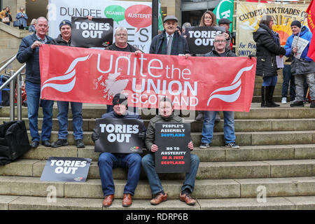 Glasgow, UK. 19th January 2019. Several hundred trades union activists and supporters attended a rally in Buchanan Street, Glasgow as a demonstration against government cuts to local services resulting in the loss of almost 50,000 jobs. Several unions were represented including UNITE, UNISON,RMT, PCS and the PRISON OFFICERS UNION Credit: Findlay/Alamy Live News - Stock Image