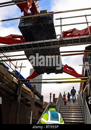 Descending into canal lock 92 on the Rochdale canal below the spider crane 9.2.19  At a Canal and River Trust public open day in Manchester. Cw 6601 - Stock Image