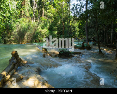 Cascade in part of three tiered Tat Kuang Si Waterfalls in Kuang Si Waterfalls Park  near Luang Prabang Laos Asia in unspoilt pristine jungle area - Stock Image