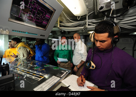 Sailors manage the flight deck aboard USS Carl Vinson. - Stock Image