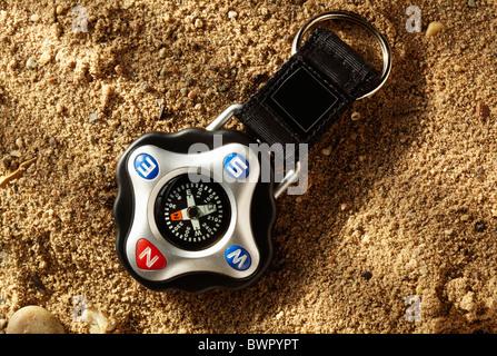 Compass on sand - Stock Image