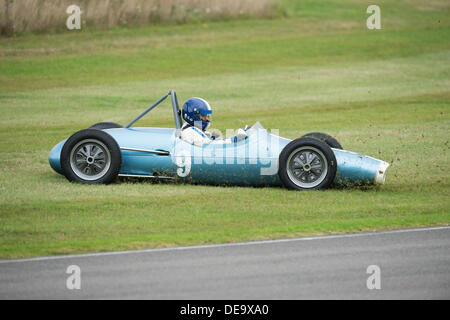 Chichester, West Sussex, UK. 13th Sep, 2013. Goodwood Revival. Goodwood Racing Circuit, West Sussex - Friday 13th September. Car no 9 spins backwards onto the grass during a qualifying session. © MeonStock/Alamy Live News - Stock Image