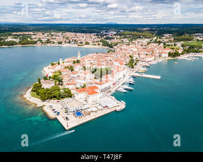 Croatian town of Porec, shore of blue azure turquoise Adriatic Sea, Istrian peninsula, Croatia. Bell tower, red tiled roofs of historical buildings, b - Stock Image