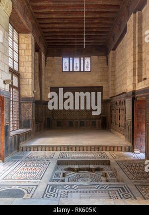 Hall at ottoman era historic house of Moustafa Gaafar Al Seleehdar located at Al Darb Al Asfar District, Cairo, Egypt with decorated wooden ceiling, m - Stock Image