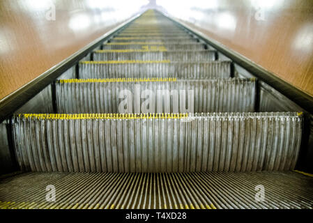 View of moving and empty escalator going up - Stock Image
