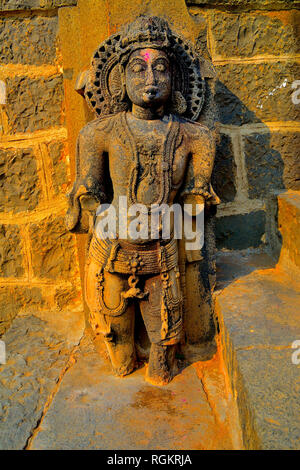 Beautifully carved idols on the outer wall of the Bhuleshwar Temple, Yawat, Maharashtra, India - Stock Image