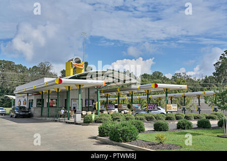Sonic Drive In fast food or casual dining restaurant, front exterior, and drive through, in Montgomery Alabama, USA. - Stock Image