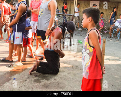 Navotas City, Philippines. 4th Jan, 2012. A flagellate seen solemnly praying at the front yard of the chapel during Good Friday. Credit: Josefiel Rivera/SOPA Images/ZUMA Wire/Alamy Live News - Stock Image