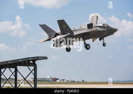 Royal Navy Cmdr. Nathan Gray and U.S. Marine Corps Maj. Michael Lippert, both F-35 Pax River ITF test pilots, conduct ski jumps and field carrier landing practices with F-35Bs on Aug. 28, 2018, at NAS Patuxent River as part of the workups for the First of Class Flight Trials aboard the HMS Queen Elizabeth.  Around 200 supporting staff from the ITF, including pilots, engineers, maintainers and data analysts, will take two F-35Bs test aircraft aboard HMS Queen Elizabeth this fall to evaluate the fifth-generation aircraft performance and integration with Royal Navy's newest aircraft carrier. This - Stock Image