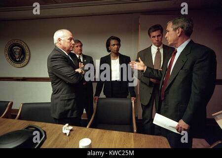 Meeting in the White House Emergency Operations Center, Sept. 11, 2001. President George W. Bush meets with, from - Stock Image