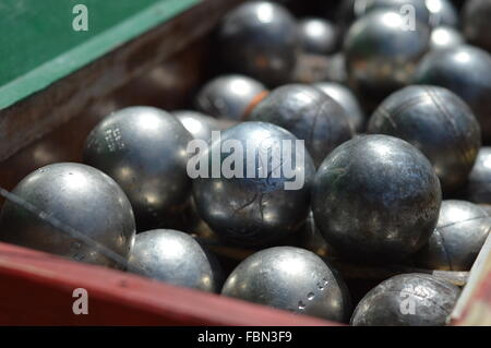 Close-Up Of Shiny Metal Balls In Container - Stock Image