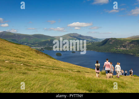 A group of young people walking near the summit of  Cat Bells (451 metres) Keswick, Cumbria, heading towards the shores of Derwent Water. - Stock Image
