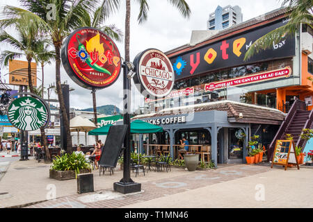 Patong Beach, Thailand - 6th January 2017: Cafes and restaurants on the main beach road. Phuket is a renowned holiday destination. - Stock Image