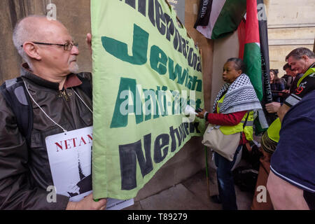 London, UK. 11th May 2019.  THe Jewish Anti-Fascist Network banner before the march from the BBC to a rally in Whitehall a few days before Nakba day showing solidarity with the Palestinian people and opposing continued Israel violation of international law and human rights. The protest called for an end to Israeli oppression and the siege of Gaza and for a just peace that recognises Palestinian rights including the right of return. It urged everyone to boycott and divest from Israel and donate to medical aid for Palestine. Peter Marshall/Alamy Live News Credit: Peter Marshall/Alamy Live News - Stock Image