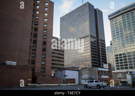 OTTAWA, CANADA - NOVEMBER 10, 2018: Pickup truck parked in a parking lot in a backyard of the CBD with business skyscrapers. Ottawa is the capital cit - Stock Image