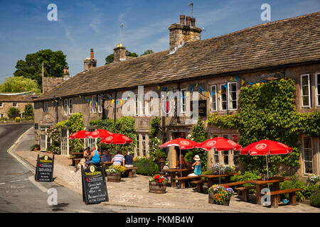 UK, Yorkshire, Wharfedale, Burnsall, Red Lion and Manor House hotel customers outside in sunshine - Stock Image
