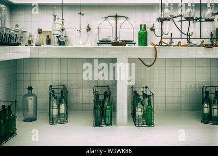 Old vintage wine laboratory. Countertop full of instruments - Stock Image