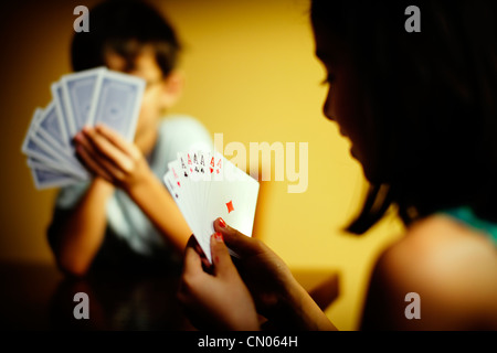 Eight Aces: children play game of cards. - Stock Image