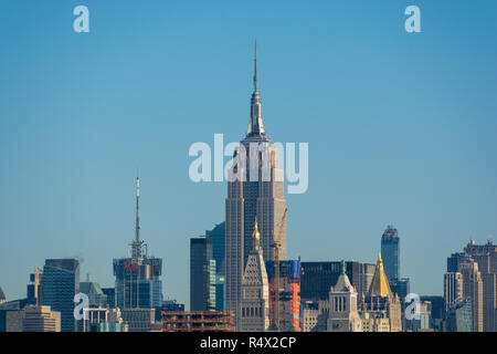 Manhattan Island buildings seen from the Brooklyn Bridge, New York City on a sunny winter day - Stock Image