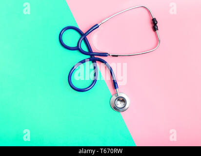 Stethoscope between green and red areas, the concept of the boundary of health and illness, healthy and unhealthy lifestyle. Risk of heart disease or  - Stock Image