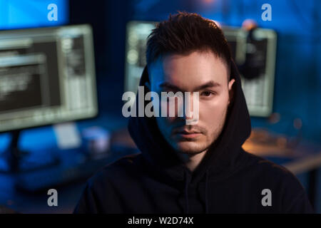 asian hacker in dark room with computers at night - Stock Image