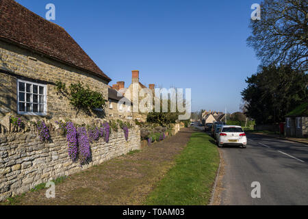 High Street, on a sunny Winter's day, in the pretty village of  Weston Underwood, Buckinghamshire, UK - Stock Image