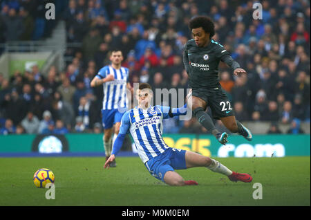 Willian of Chelsea evades a tackle from Solly March of Brighton during the Premier League match between Brighton - Stock Image
