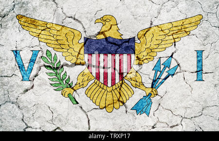 Flag of the United States Virgin Islands on dry earth ground texture background - Stock Image