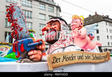 Düsseldorf, Germany. 4 March 2019. The annual Rosenmontag (Rose Monday or Shrove Monday) carnival parade takes place in Düsseldorf. Donald Trump watching over Mohammed bin Salman, crown prince of Saudi Arabia, who is wielding a chain saw. Carnival float designed by German artist Jacques Tilly. - Stock Image