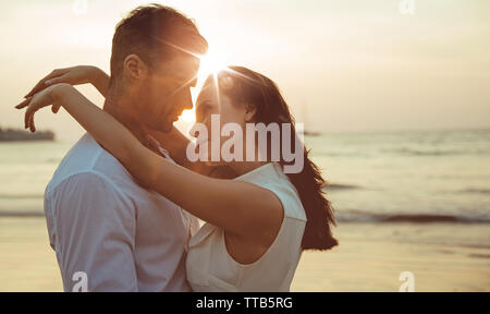 Romantic portrait of a young, cheerful couple - Stock Image