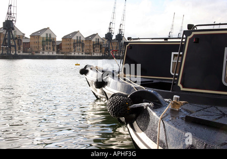 two holiday barges at looking across the river to new luxury flat developments - Stock Image