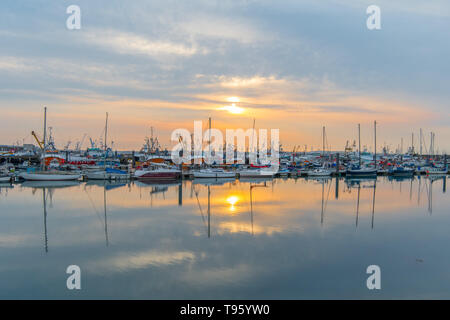 Newlyn, Cornwall, UK. 17th May 2019. UK Weather.  Calm and mild for sunrise this morning at Newlyn. Rain is forecast to move in from the east later on today. Credit Simon Maycock / Alamy Live News. - Stock Image