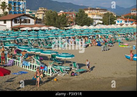 a crowded beach in Marina di Massa, Versilia, Tuscany, Italy - Stock Image