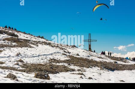Tourists near cross on Sass Pordoi mountain in the Dolomites near Canazei, northern Italy, Europe - Stock Image