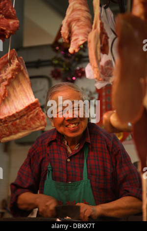 Fish and meat market fishmonger stall butcher - Stock Image
