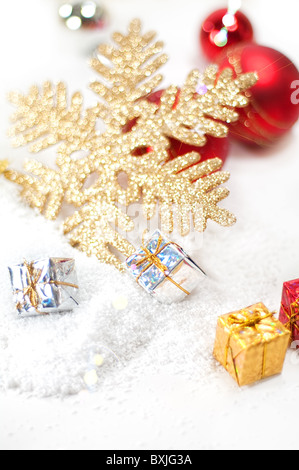 Christmas decoration with baubles,gift boxes and snowflake - Stock Image